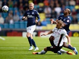 Ricardo Fuller of Millwall FC and Joe Skarz of Rotherham United during the Sky Bet Championship match between Millwall and Rotherham United at The Den on August 23, 2014