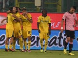 Nicola Ferrari of Modena celebrates with team mates after scoring the opening goal during the TIM Cup match between US Citta di Palermo v Modena FC at Stadio Renzo Barbera on August 23, 2014