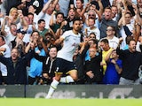 Spurs fans celebrate the opening goal by Nacer Chadli of Spurs during the Barclays Premier League match against QPR on August 24, 2014