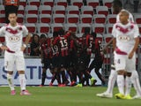 Nice's French forward Alexy Bosetti is congratulated by teammates after scoring a goal during the French L1 football match Nice (OGCN) vs Bordeaux (FCGB) on August 23, 2014
