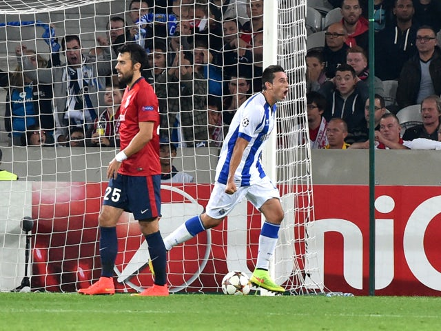 Porto's Mexican midfielder Hector Herrera celebrates after scoring a goal during the UEFA Champions League play-off first leg football match between Lille and Porto at the Pierre Mauroy Stadium in Villeneuve d'Ascq, northern France, on August 20, 2014