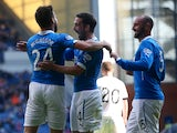 Darren McGregor celebrates with team mates Nicky Clark and Kris Boyd after he scores during the Scottish Championship League Match between Rangers and Dumbarton, at Ibrox Stadium on August 23, 2014