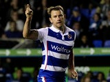 Simon Cox of Reading celebrates after scoring his team's first goal of the game during the Sky Bet Championship match between Reading and Huddersfield Town at Madejski Stadium on August 19, 2014