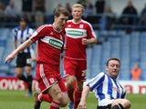 Steve Howard of Sheffield Wednesday contests the ball with Richard Smallwood of Middlesbrough during the npower Championship match between Sheffield Wednesday and Middlesbrough at Hillsborough Stadium on May 4, 2013
