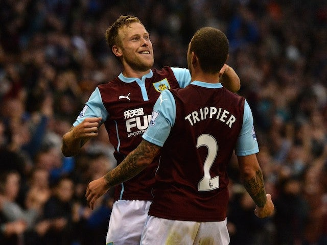 Burnley's Scottish midfielder Scott Arfield (L) celebrates with Burnley's English defender Kieran Trippier (R) after scoring the opening goal of the English Premier League football match against Chelsea on August 18, 2014