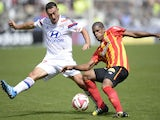 Lyon's French midfielder Steed Malbranque (L) vies for the ball with Lens' French defender Ludovic Baal (R) during the French L1 football match on August 24, 2014