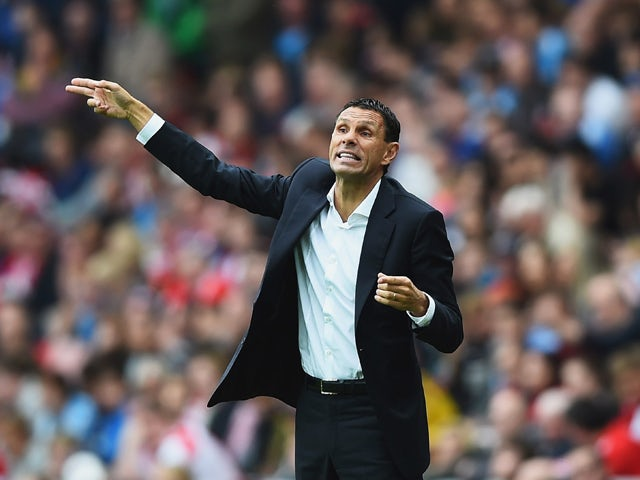 Manager Gustavo Poyet of Sunderland gives instructions during the Barclays Premier League match between Sunderland and Manchester United at Stadium of Light on August 24, 2014