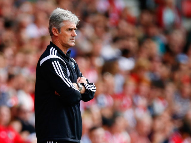 Manager Alan Irvine of West Brom looks on during the Barclays Premier League match between Southampton and West Bromwich Albion at St Mary's Stadium on August 23, 2014