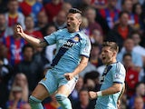 Mauro Zarate of West Ham celebrates scoring the opening goal with Aaron Cresswell of West Ham during the Barclays Premier League match between Crystal Palace and West Ham United at Selhurst Park on August 23, 2014