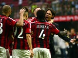 AC Milan's midfielder of Ghana Sulley Ali Muntari celebrates with AC Milan's coach Filippo Inzaghi after scoring during the Serie A football match AC Milan against Lazio on August 31, 2014