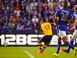 Alexis Sanchez of Arsenal scores his team's opening goal during the Barclays Premier League match against Leicester City on August 31, 2014