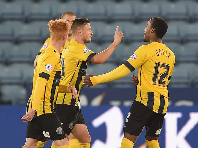 Andrew Mangan of Shrewsbury celebrates scoring to make it 1-0 during the Capital One Cup second round match against Leicester City on August 26, 2014