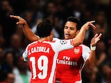 Alexis Sanchez of Arsenal celebrates with team mate Santi Cazorla of Arsenal after scoring during the UEFA Champions League Qualifier 2nd leg match between Arsenal and Besiktas at the Emirates Stadium on August 27, 2014