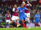 Kieran Richardson of Aston Villa and Jay Simpson of Leyton Orient vie for the ball during the Capital One Cup second round match between Aston Villa and Leyton Orient at Villa Park on August 27, 2014