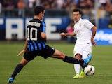 Raffa Marquez of Verona is challenged by Giacomo Bonaventura during the Serie A match between Atalanta BC and Hellas Verona FC at Stadio Atleti Azzurri d'Italia on August 31, 2014
