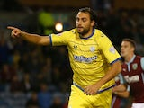 Atdhe Nuhiu of Sheffield Wednesday runs away to celebrate after scoring his teams first goal from the penalty spot during the Capital One Cup Second Round match on August 26, 2014