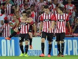 Athletic Bilbao's forward Aritz Aduriz celebrates with his teammates after scoring his second goal during the UEFA Champions League play-off second leg football match Athletic Bilbao vs SSC Napoli at the San Mames stadium in Bilbao on August 27, 2014