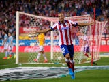 Joao Miranda of Atletico de Madrid celebrates scoring their opening goal during the La Liga match between Club Atletico de Madrid and SD Eibar at Vicente Calderon Stadium on August 30, 2014