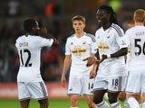 Swansea's Nathan Dyer and Bafetimbi Gomis celebrate during the Capital One Cup Second Round match against Rotherham on August 26, 2014
