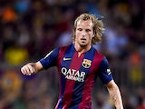 Ivan Rakitic of FC Barcelona runs with the ball during the Joan Gamper Trophy match between FC Barcelona and Club Leon at Camp Nou on August 18, 2014