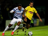 Robbie Weir of Burton tackles Matt Phillips of QPR during the Capital One Cup Second Round match between Burton Albion and Queens Park Rangers at Pirelli Stadium on August 27, 2014