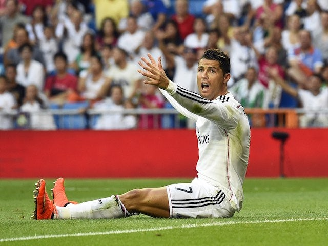 A frustrated Cristiano Ronaldo sits on the pitch during Real Madrid's encounter with Cordoba on August 25, 2014