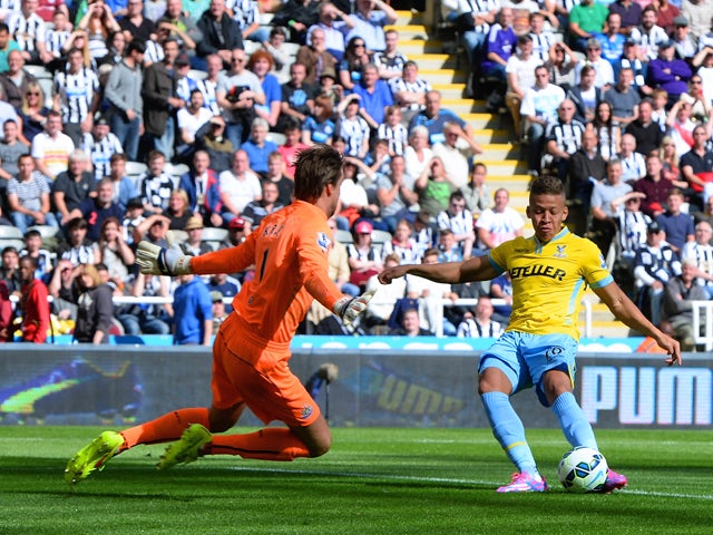 Dwight Gayle of Crystal Palace scores the opening goal past Tim Krul of Newcastle United during the Barclays Premier League match between Newcastle United and Crystal Palace at St James' Park on August 30, 2014