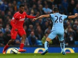 Liverpool's Daniel Sturridge comes up against Man City's Martin Demichelis on August 25, 2014