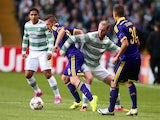 Agim Ibraimi of NK Maribor vies with Jo Inge Berget of Celtic during the UEFA Champions League Qualifying Play-Offs Round, Second Leg Match on August 26, 2014