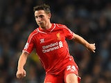 Joe Allen of Liverpool in action during the Barclays Premier League match between Manchester City and Liverpool at the Etihad Stadium on August 25, 2014