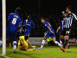 John Egan of Gillingham scores an own goal during the Capital One Cup second round match against Newcastle United on August 26, 2014