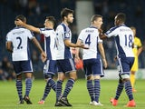 West Brom players celebrate after Jonny Mullins of Oxford United scores an own goal during the Capital One Cup second round match on August 26, 2014