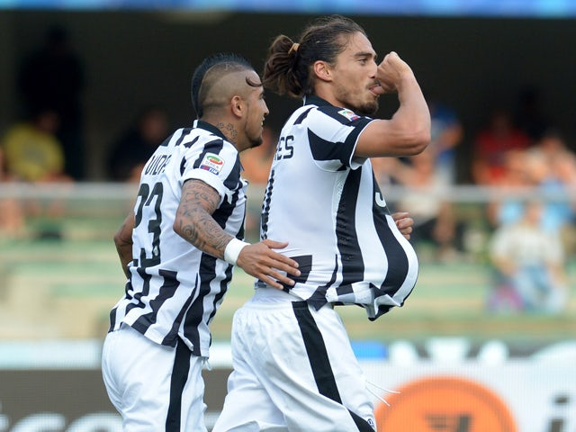 Martin Caceres of Juventus celebrates after scoring his opening goal during the Serie A match between AC Chievo Verona and Juventus FC at Stadio Marc'Antonio Bentegodi on August 30, 2014