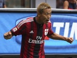 Keisuke Honda of AC Milan celebrates after scoring the opening goal during the Serie A match between AC Milan and SS Lazio at Stadio Giuseppe Meazza on August 31, 2014