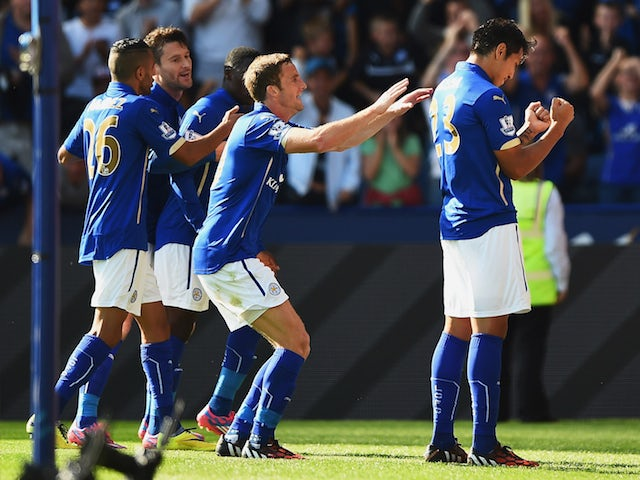 Leonardo Ulloa (R) of Leicester City celebrates scoring his team's opening goal with team mates during the Barclays Premier League match against Arsenal on August 2014, 2014