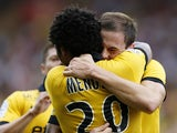 Lille's French forward Nolan Roux celebrates with Lille's Cape Verdean forward Ryan Mendes after Roux scored a goal during the French L1 football match Monaco (ASM) vs Lille (LOSC) on august 30, 2014