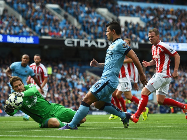 Sergio Aguero of Manchester City has a shot saved by Asmir Begovic of Stoke City during the Barclays Premier League match between Manchester City and Stoke City at Etihad Stadium on August 30, 2014