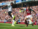 Antonio Valencia of Manchester United goes into to block Matthew Taylor of Burnley during the Barclays Premier League match between Burnley and Manchester United at Turf Moor on August 30, 2014