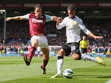 Robin van Persie of Manchester United and Michael Duff of Burnley battle for the ball during the Barclays Premier League match between Burnley and Manchester United at Turf Moor on August 30, 2014