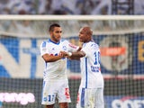 Marseille's French forward Dimitri Payet celebrates with Marseille's Ghanaian forward Andre Ayew after scoring his second goal during the French L1 football match Olympique de Marseille vs OGC Nice on August 29, 2014