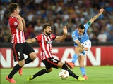 Mikel Balenziaga of Athletic Bilbao and Marek Hamsik of Napoli in action during the first leg of UEFA Champions League qualifying play-offs round match between SSC Napoli and Athletic Club on August 19, 2014