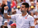 Novak Djokovic of Serbia celebrates his 6-3, 6-2, 6-2 win over Sam Querrey of the US during their 2014 US Open men's singles match at the USTA Billie Jean King National Tennis Center on August 30, 2014