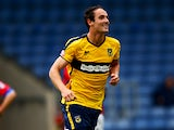 Danny Hylton of Oxford United celebrates after scoring his sides third goal during the Sky Bet League Two match between Oxford United and Dagenham & Redbridge at Kassam Stadium on August 30, 2014