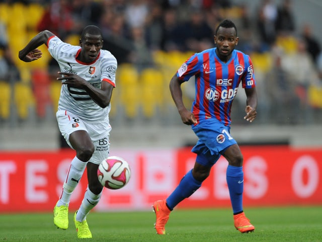 Rennes' French midfielder Abdoulaye Doucoure vies for the ball with Caen's French forward Lenny Nangis during the French L1 football match between Caen (SM Caen) and Stade Rennais (SRFC) on August 30, 2014