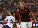 Radja Nainggolan of AS Roma celebrates after scoring the opening goal during the Serie A match between AS Roma and ACF Fiorentina at Stadio Olimpico on August 30, 2014