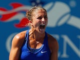Sara Errani of Italy celebrates after defeating Venus Williams of the United States in their women's singles third round match on Day Five of the 2014 US Open at the USTA Billie Jean King National Tennis Center on August 29, 2014