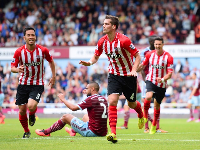 Morgan Schneiderlin of Southampton celebrates scoring the equalising goal during the Barclays Premier League match between West Ham United and Southampton at Boleyn Ground on August 30, 2014