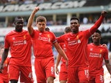 Liverpool's English midfielder Steven Gerrard (R) celebrates scoring a penalty against Tottenham on August 31, 2014