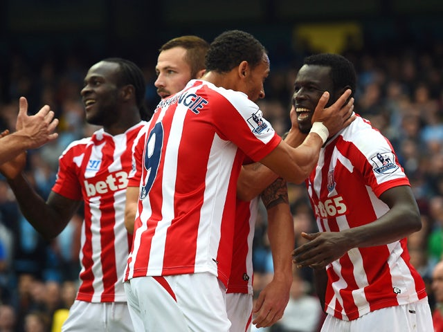 Mame Biram Diouf of Stoke City celebrates scoring the opening goal with team mates during the Barclays Premier League match between Manchester City and Stoke City at Etihad Stadium on August 30, 2014