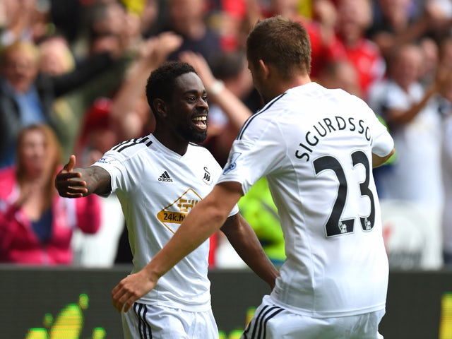 Swansea player Nathan Dyer celebrates after opening the scoring during the Barclays Premier League match between Swansea City and West Bromwich Albion at Liberty Stadium on August 30, 2014